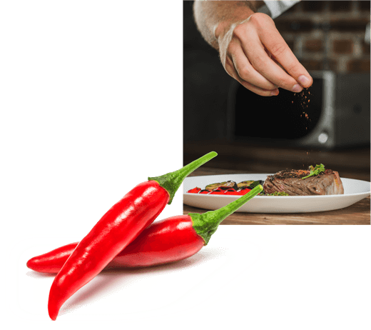 A photo of a chef's hand adding spices to a plated dish of steak and grilled vegetables, overlayed by an image of two fresh Calabrian chili peppers.